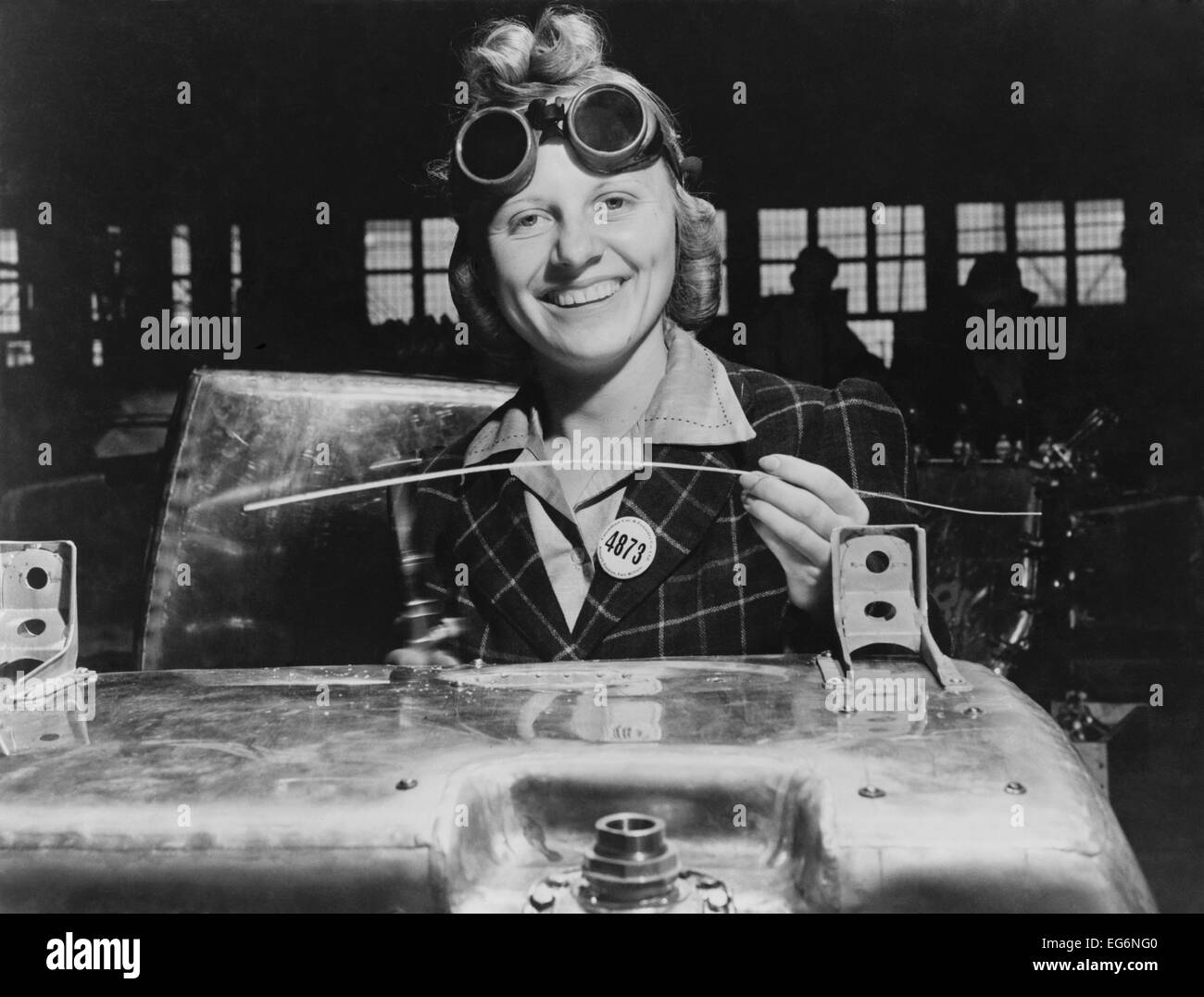 Woman welding a fuel tank for a Hawker Hurricane fighter airplane at Fort William, Ontario, Canada. 1941. World - Stock Image