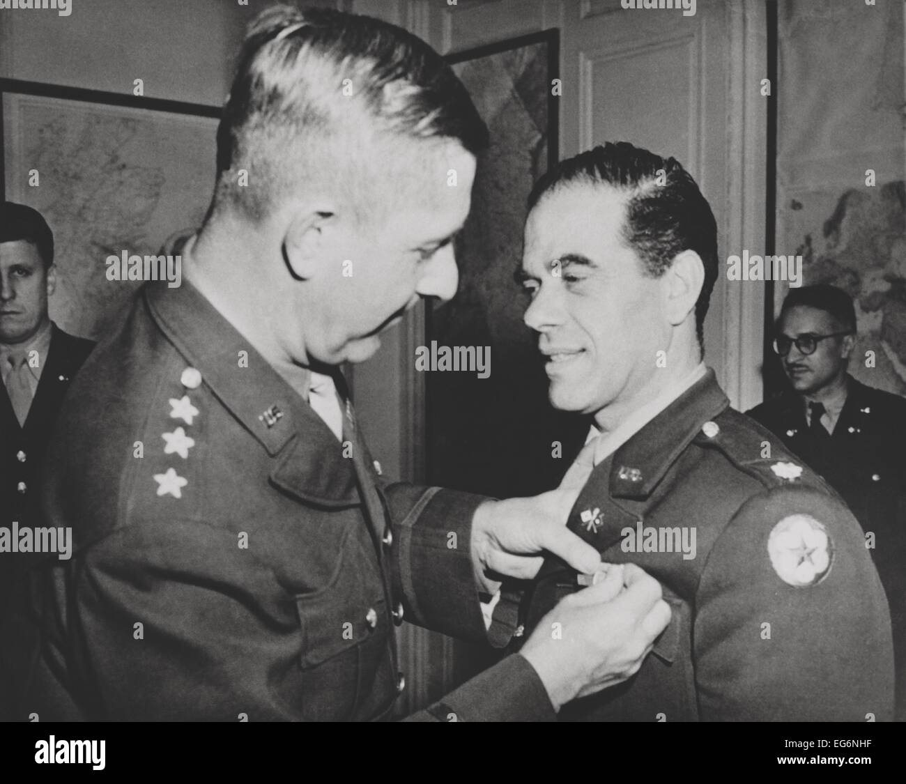 Lt. Col. Frank Capra, receives the Legion of Merit. The Hollywood movie director was chief of the U.S. Army Signal Stock Photo