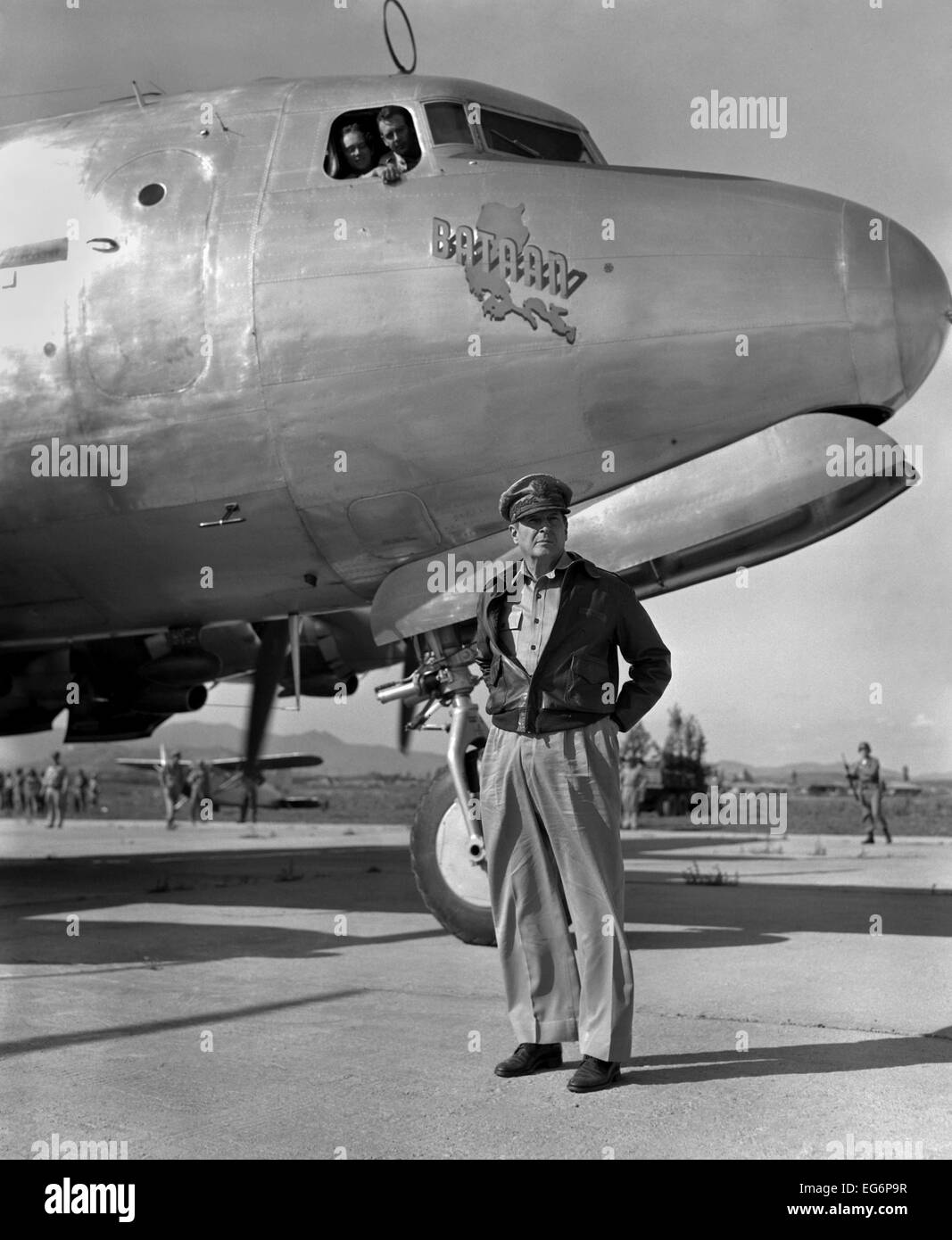 General Douglas MacArthur on his arrival at Kimpo airfield for a tour of the Korean battlefront. His aircraft bears - Stock Image