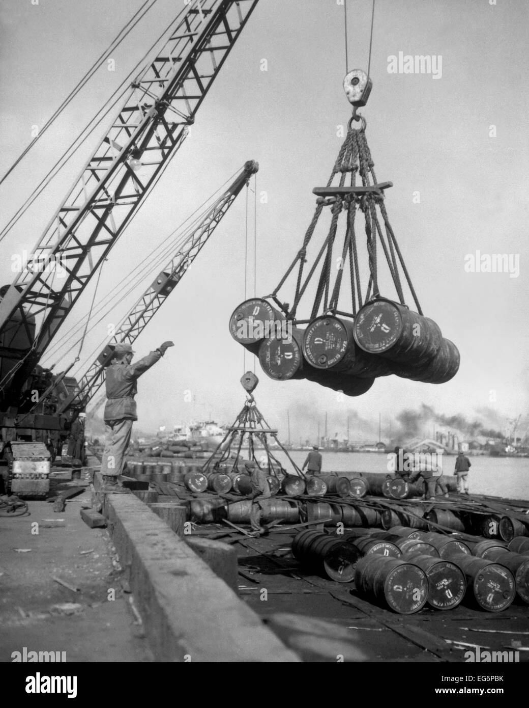 Fuel Drums Are Lifted And Moved With Cranes From A Tanker At Inchon Harbor Korea