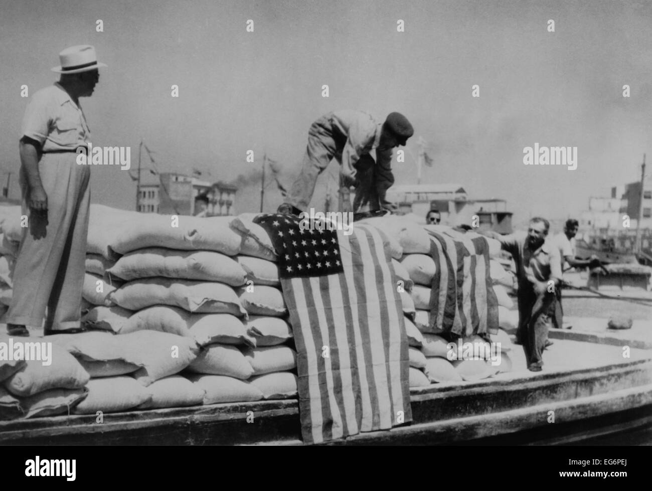 Sacks of flour, the first relief supplies from the United States, being unloaded in the port of Piraeus. American Stock Photo