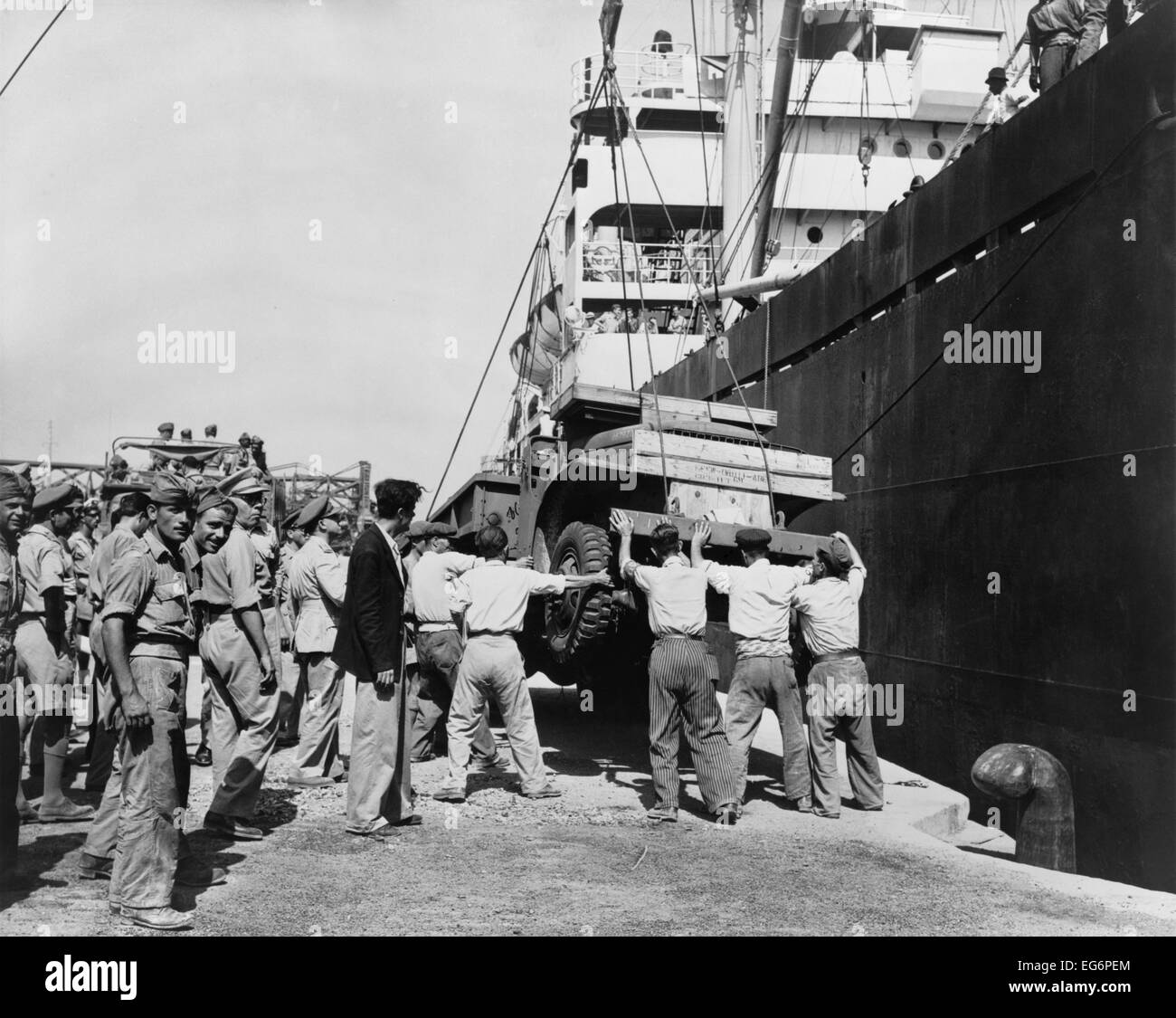 American-made truck lowered from a freighter at Piraeus as part of a relief effort to Greece. U.S. aid supported Stock Photo