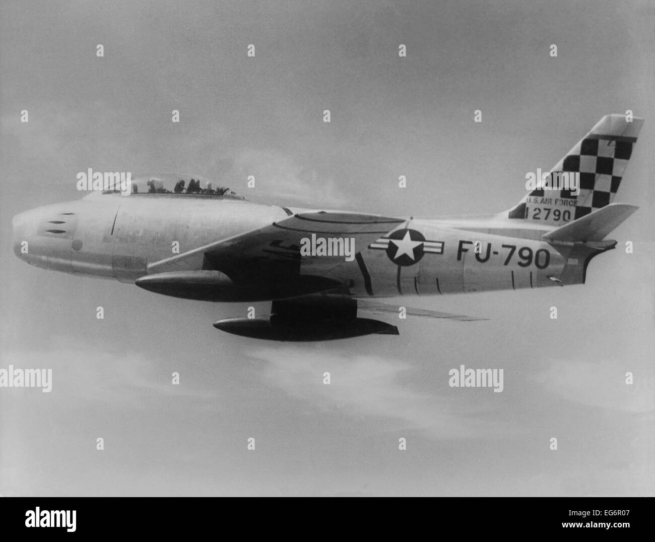 F-86 Sabre Jet was the first U.S. jet fighter to have swept wings. This one is headed toward 'MIG Alley' - Stock Image