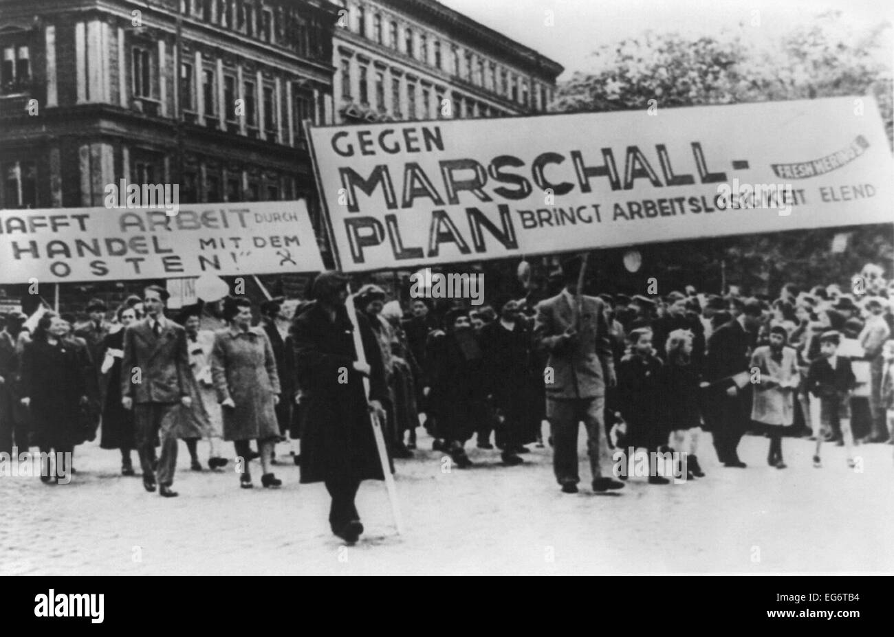 East Germans demonstrate against Marshall Plan. The sign translates to 'Against Marshall Plan Brings Unemployment - Stock Image