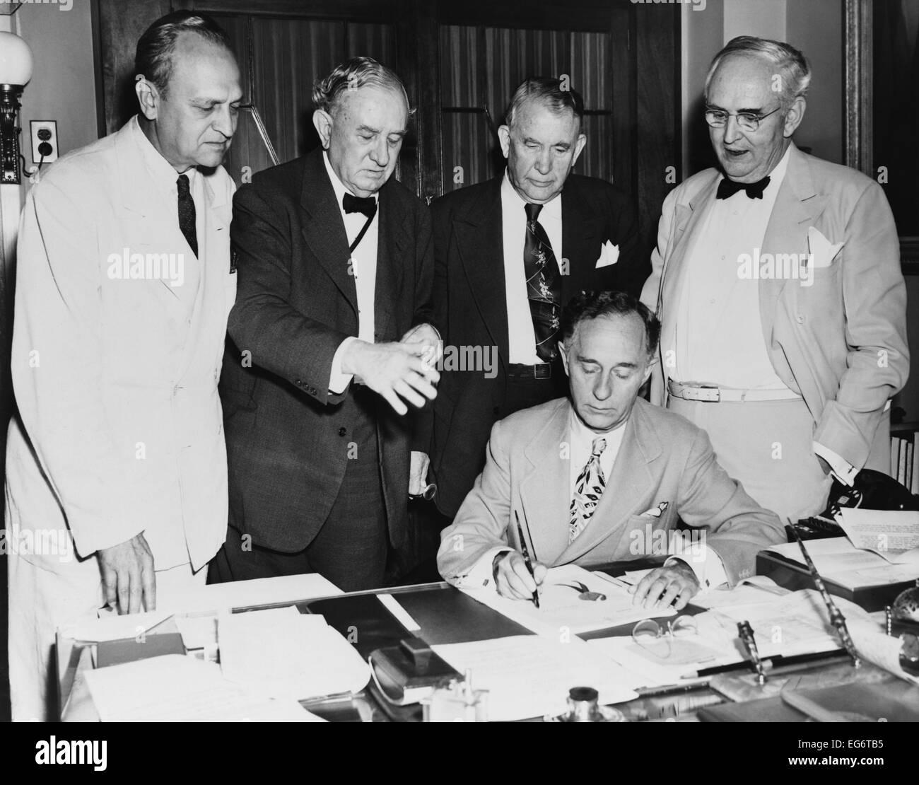 North Atlantic Treaty Organization, NATO, is ratified by U.S. Senate. July 21, 1949. Leslie Biffle, Secretary signs Stock Photo