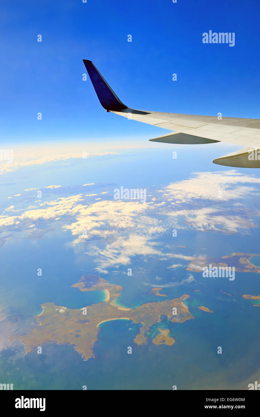 view from the airplane window over the ocean - Stock Image