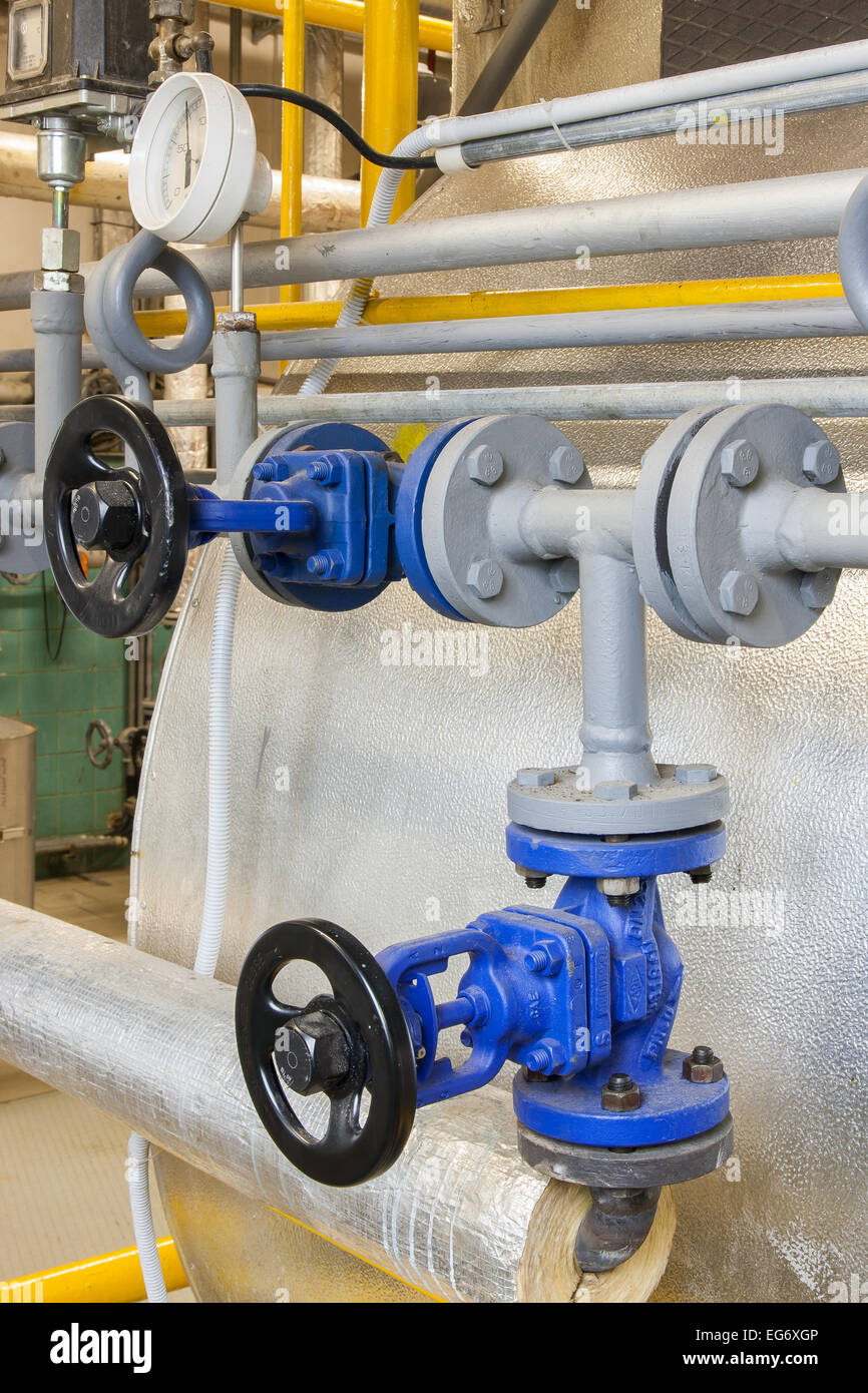 Pipes and faucet valves of heating system in a boiler room Stock ...