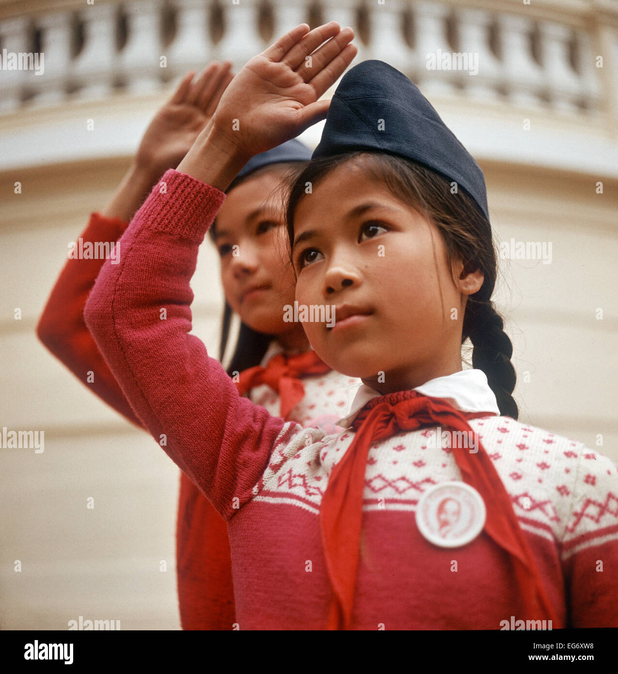Two vietnamese girls with cap and red scarf the hand up for the two vietnamese girls with cap and red scarf the hand up for the pioneer greeting photographed in march 1973 in north vietnam only a few weeks before m4hsunfo Choice Image