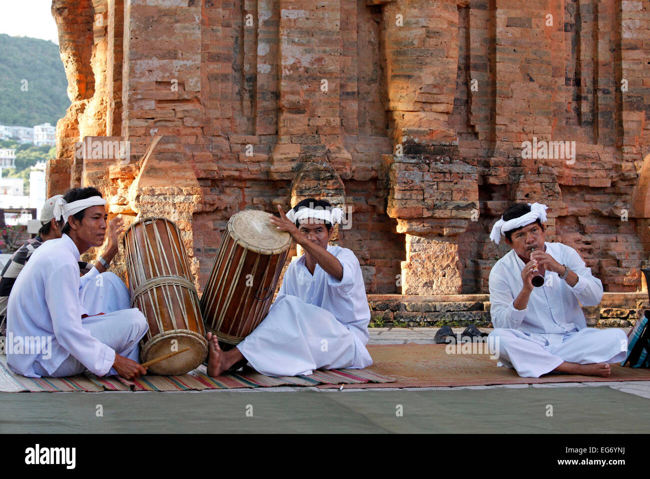 Cham playing traditional music at the Po Nagar Cham Towers in Nha Trang, Vietnam. - Stock Image