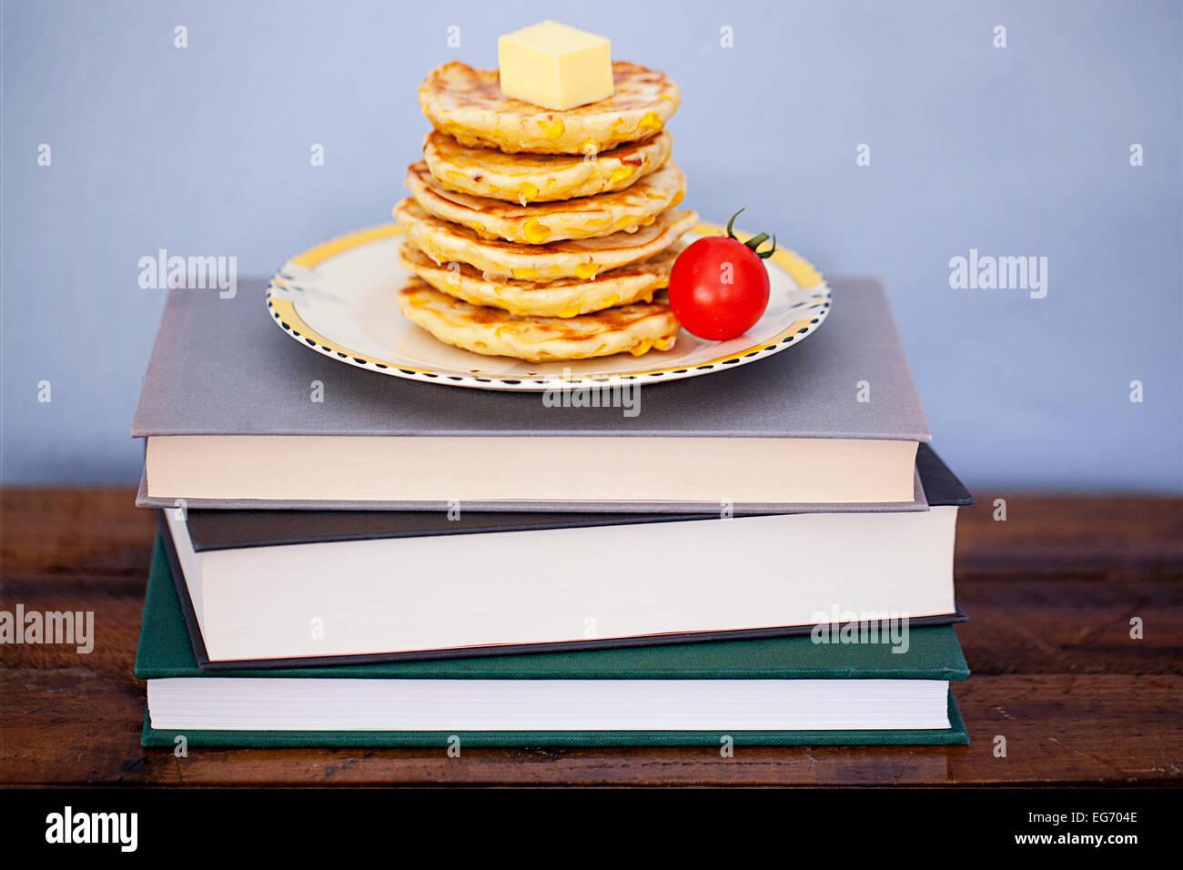 corn fritters flapjacks cheese and tomatoe - Stock Image