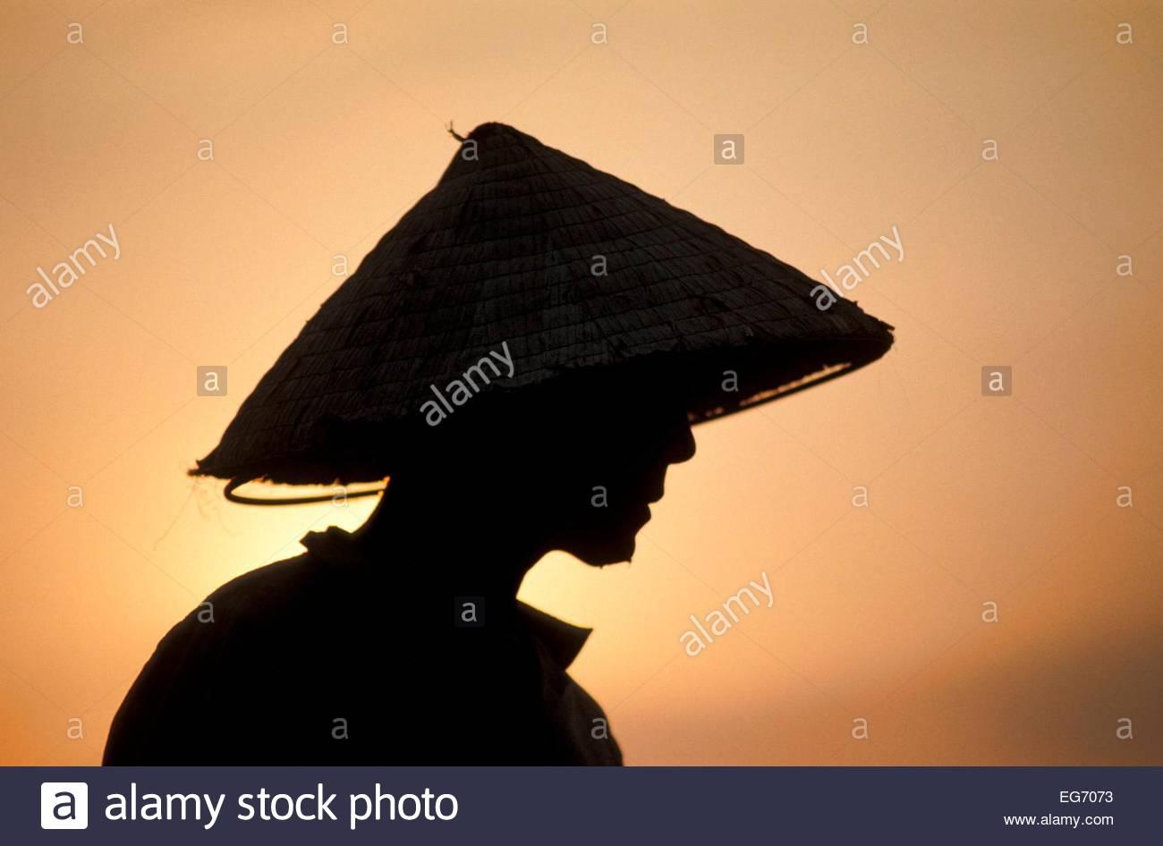 Vietnamese Farmer At Sunset - Stock Image