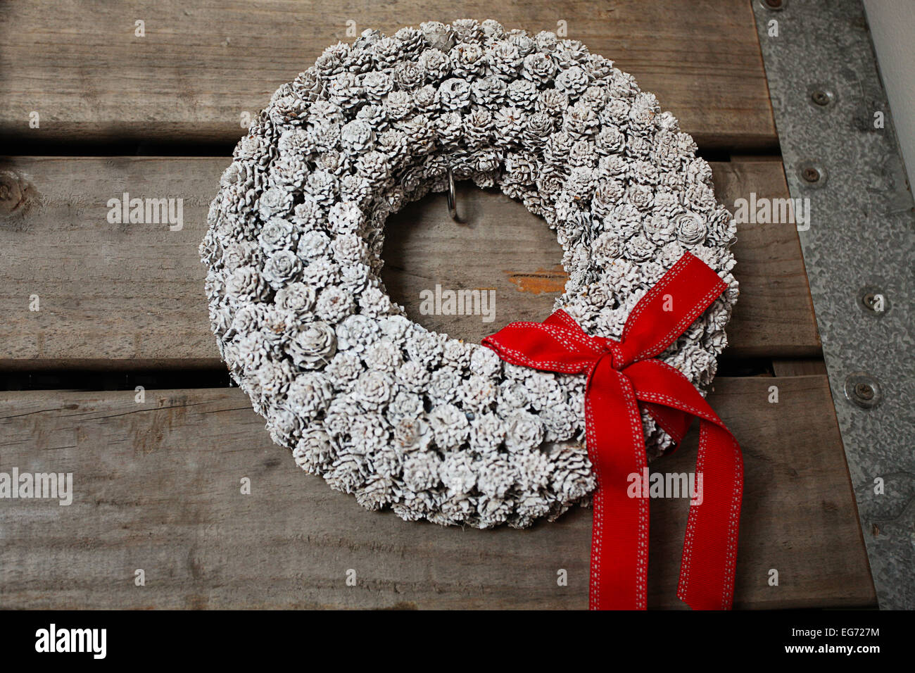 Homemade Christmas wreath with red bow - Stock Image