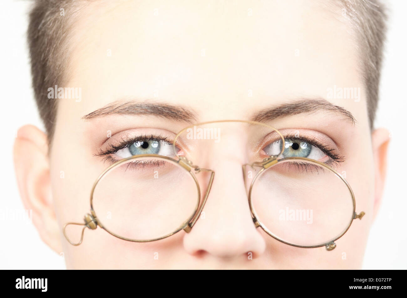Girl with Old Eyeglasses - Stock Image
