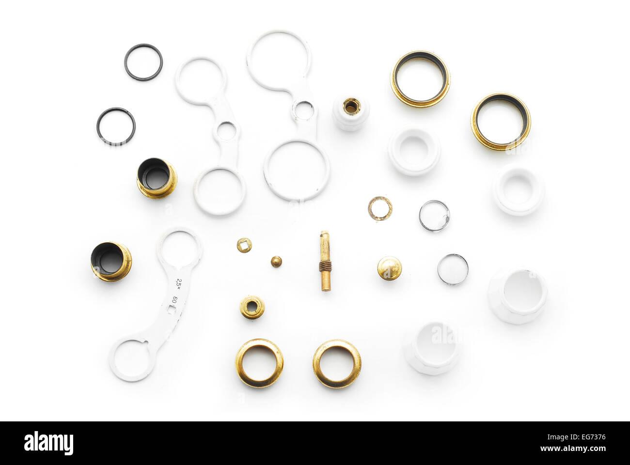 disassembled binocular parts on white - Stock Image