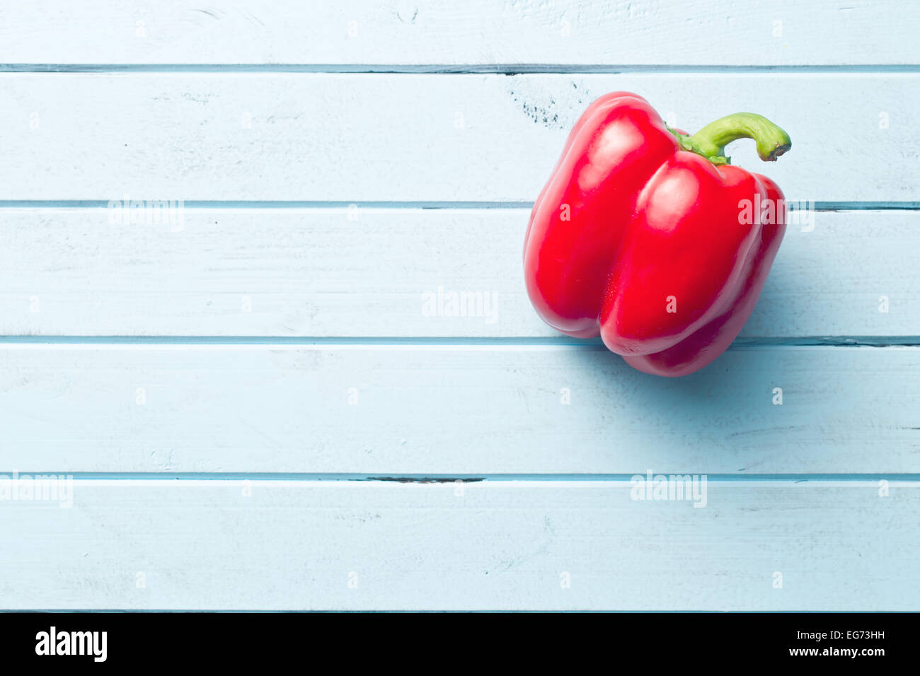red pepper on kitchen table Stock Photo