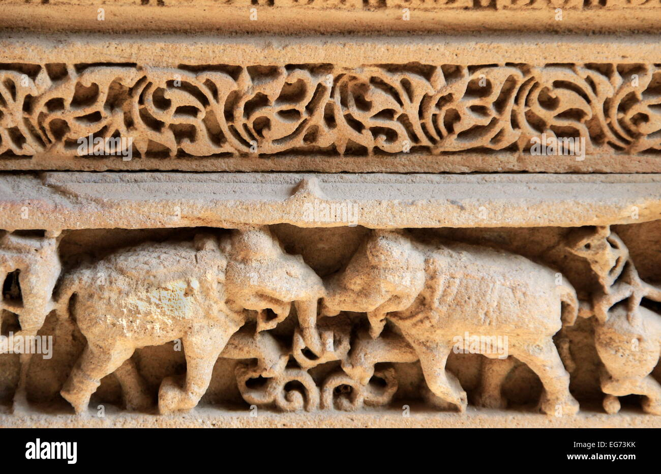 Beautiful carving of elephants on wall at Adalaj Step Well, Ahmedabad, Gujarat, India, Asia - Stock Image