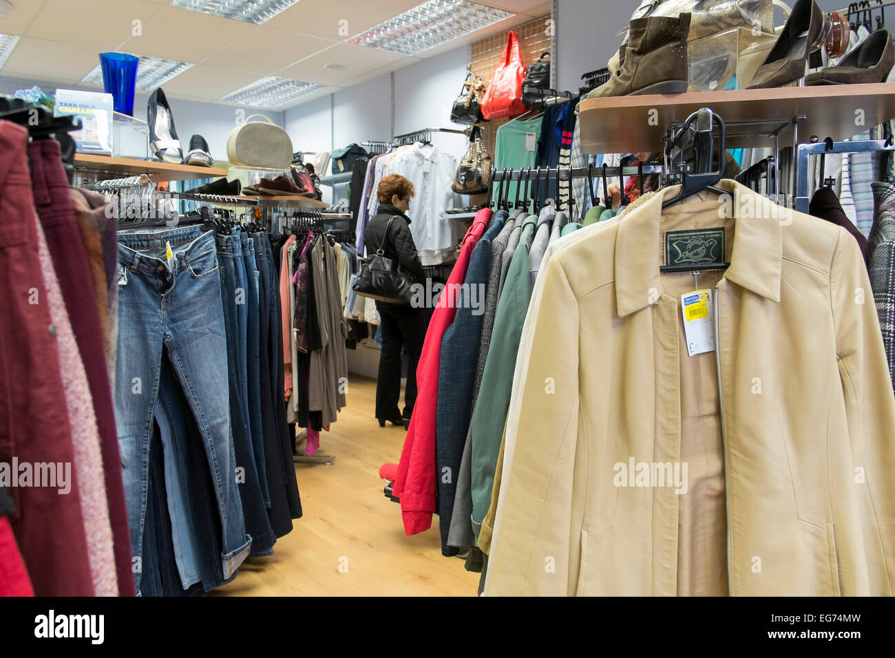The interior of a charity shop. - Stock Image