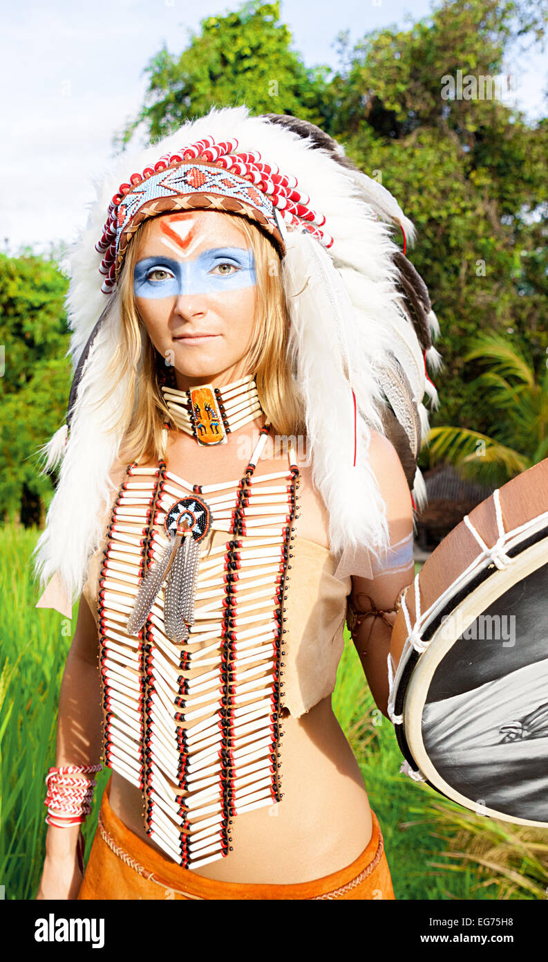 Native American, Indians in traditional dress, standing, rice field, day time, tambourine - Stock Image