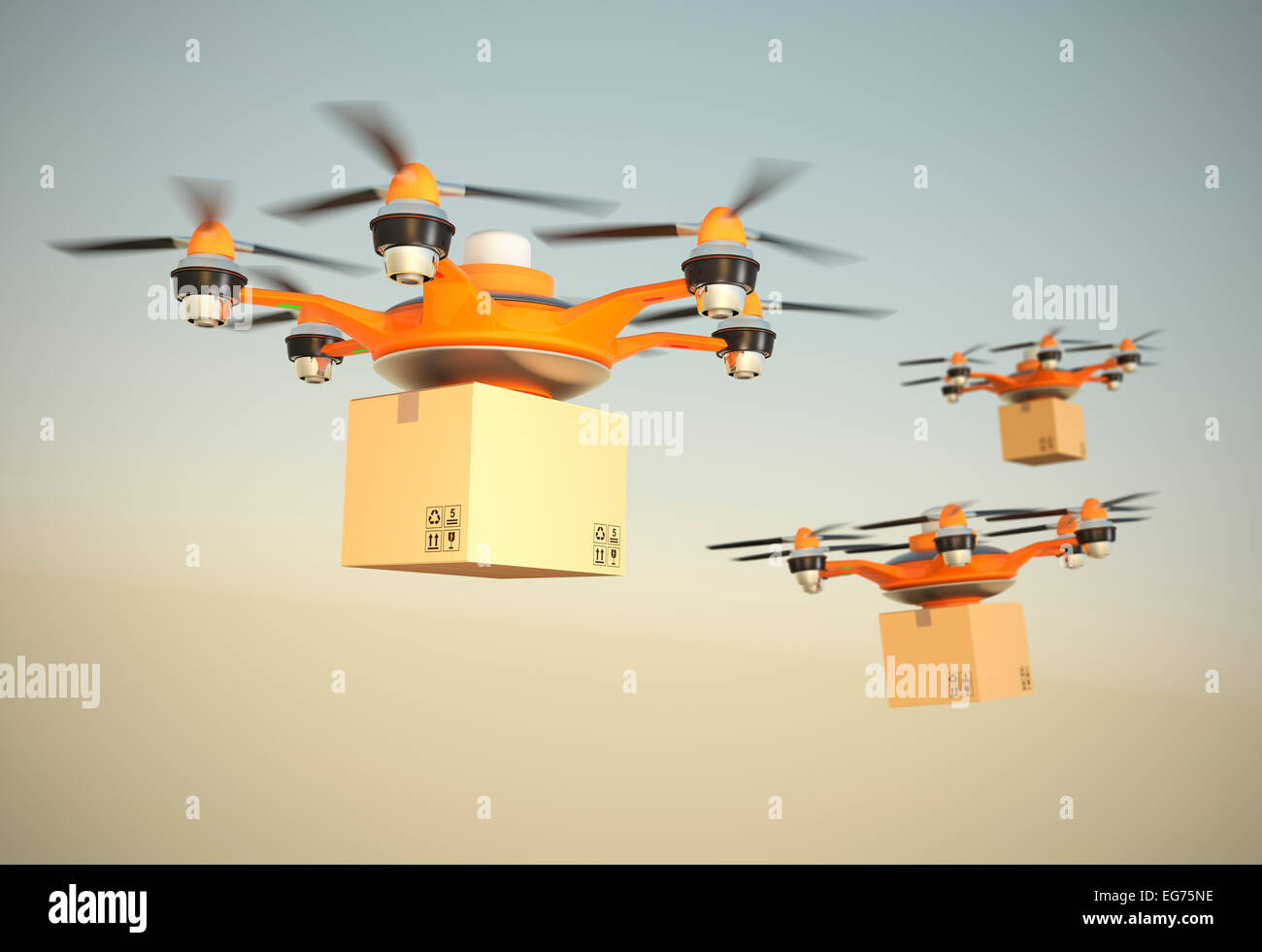 Hexacopter carrying cardboard boxes in mid air. - Stock Image