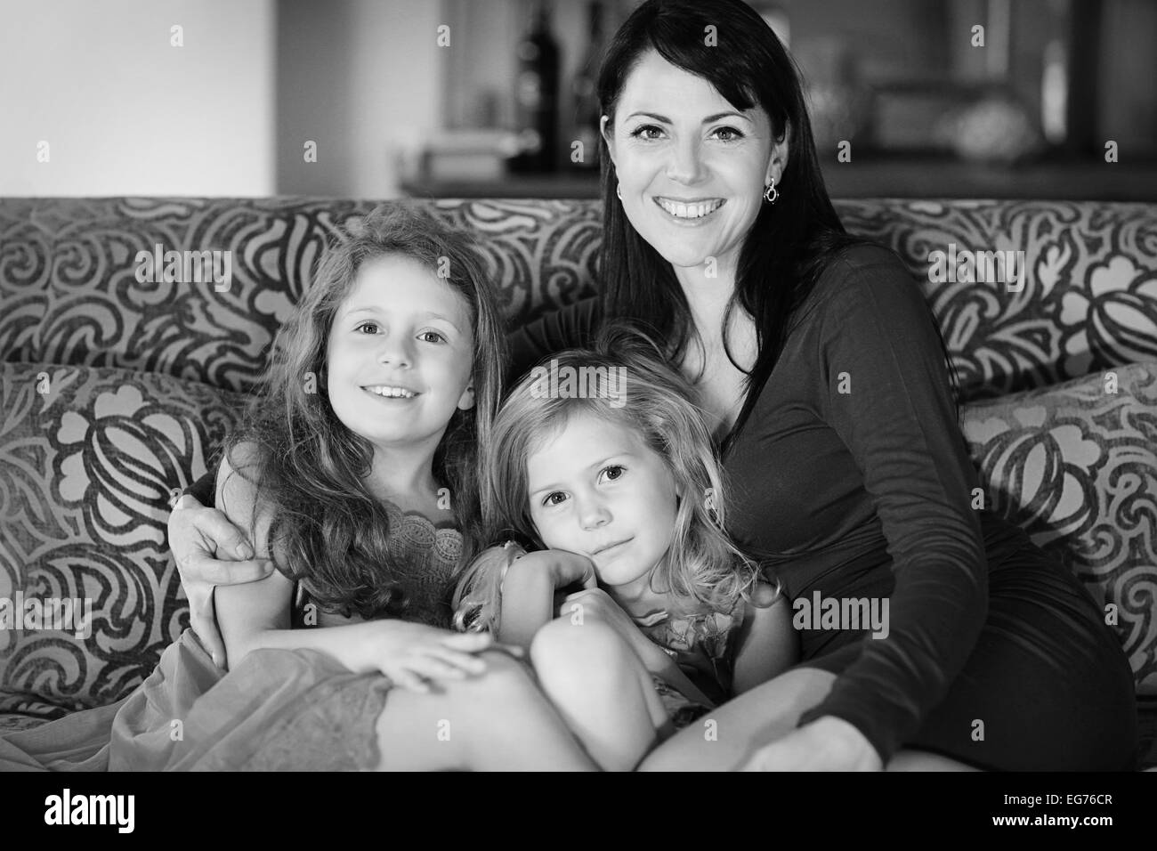 Single mom and her two pretty daughters - Stock Image