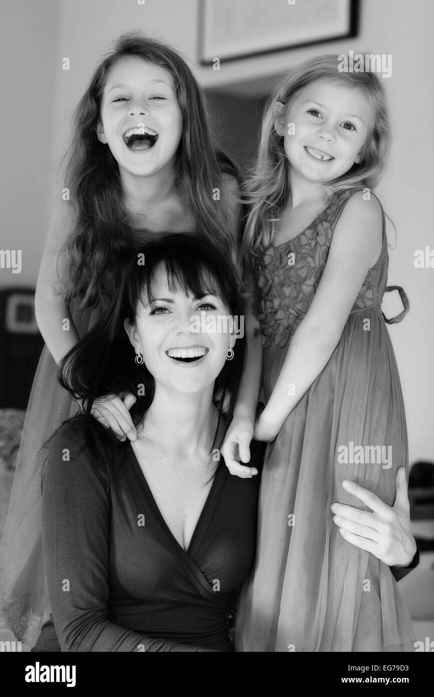 Single mom and her two pretty daughters in black and white - Stock Image