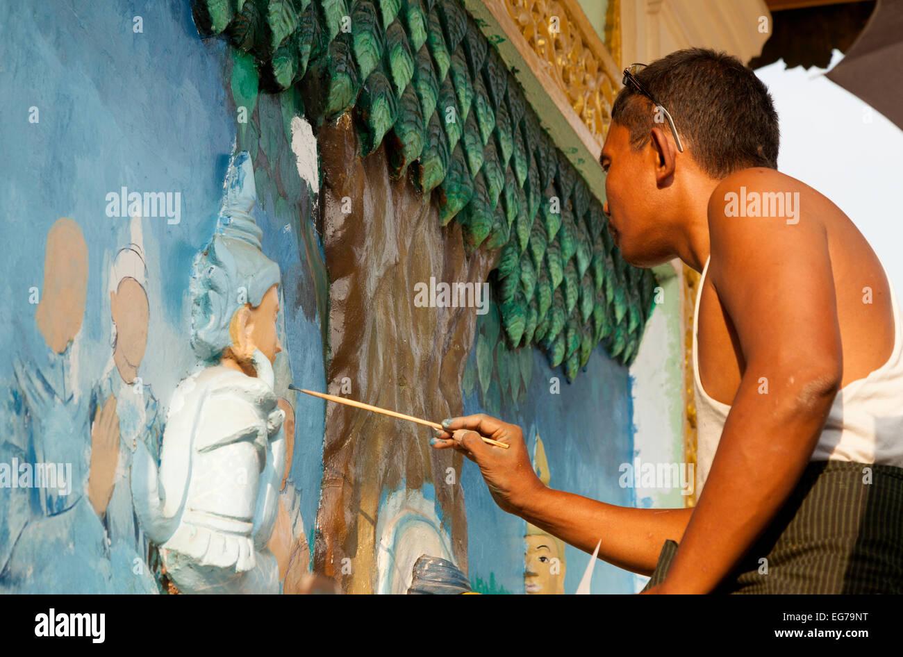 A burmese painter painting religious pictures, Shwedagon Pagoda, Yangon, Myanmar ( Burma ), Asia - Stock Image