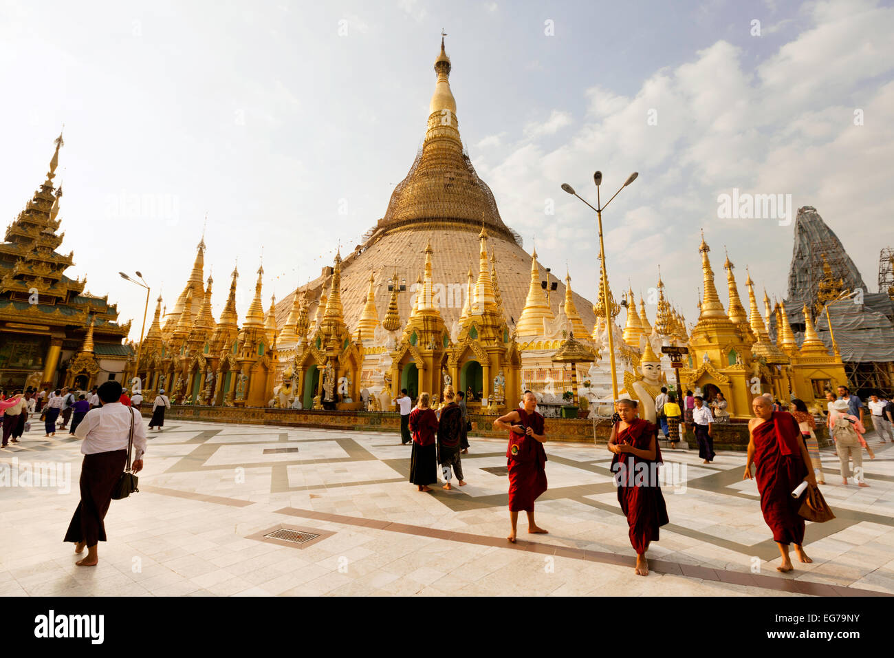 Buddhist monks at the Shwedagon Pagoda, Yangon, Myanmar ( Burma ), Asia Stock Photo