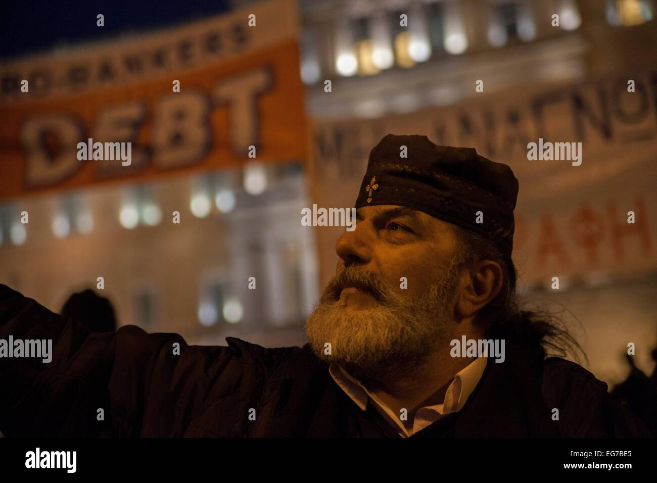 Greek orthodox priest. Greek Priest supports protest of Greeks for support for negotiation economic situation of - Stock Image