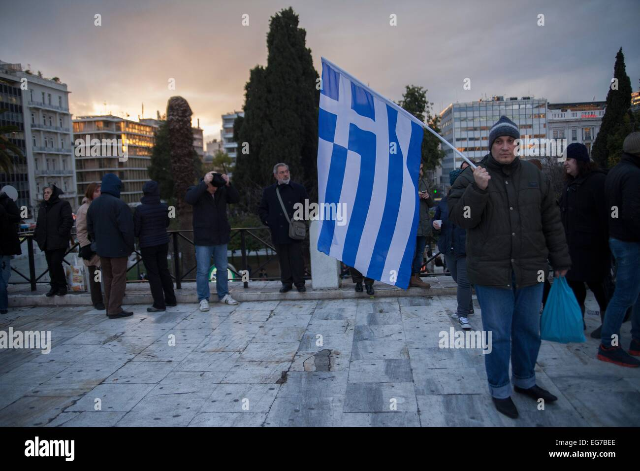 Greek man with Greek flag. Protest of Greeks for support for negotiation economic situation of Greece. 16.02.2015 - Stock Image