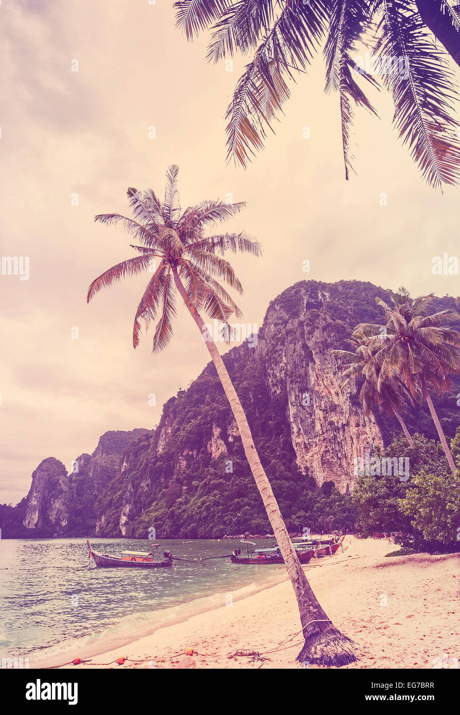 Vintage retro stylized tropical beach with palm trees. - Stock Image
