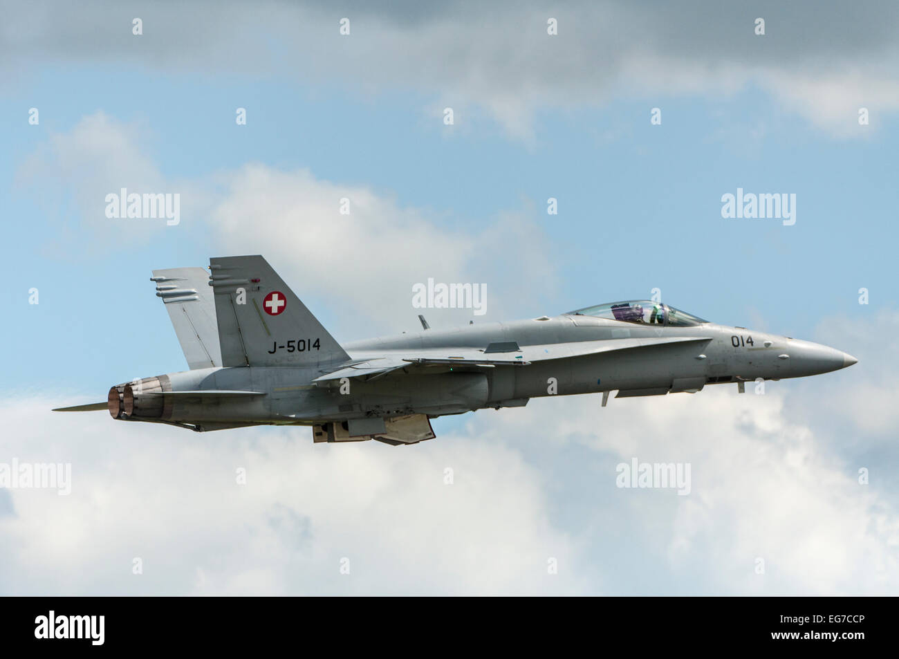 Swiss airforce F/A - 18C Hornet in cloudy sky - Stock Image
