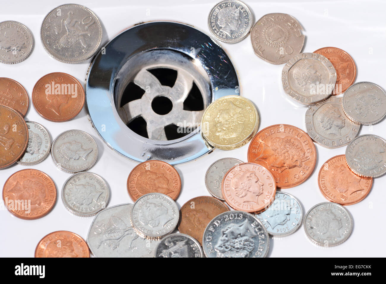 Wasted money going down the drain Stock Photo