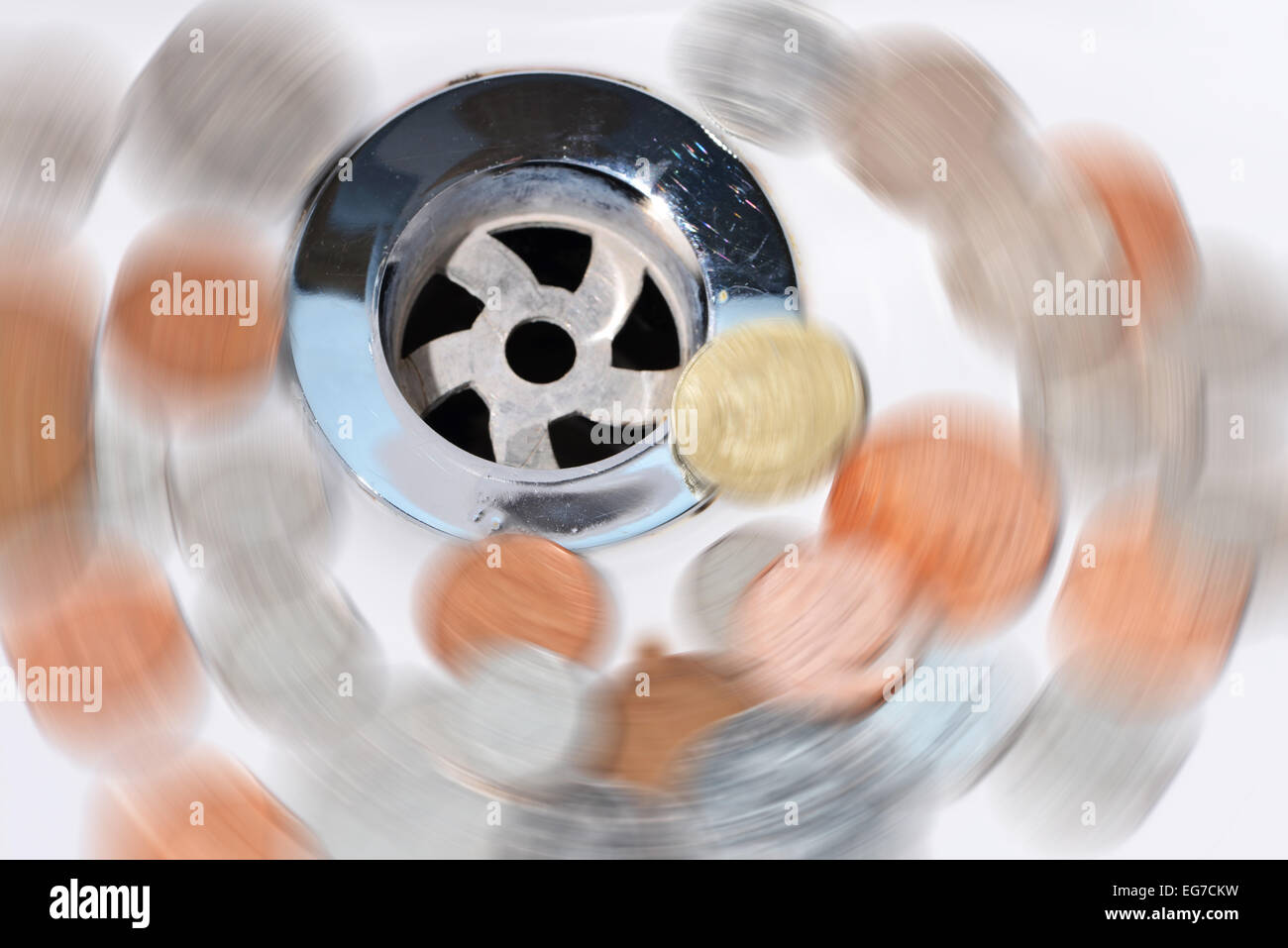 Wasted money going down the drain - Stock Image