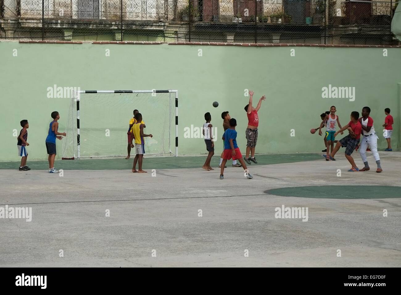 School children playing handball in a social sports arena, Havana, Cuba. - Stock Image