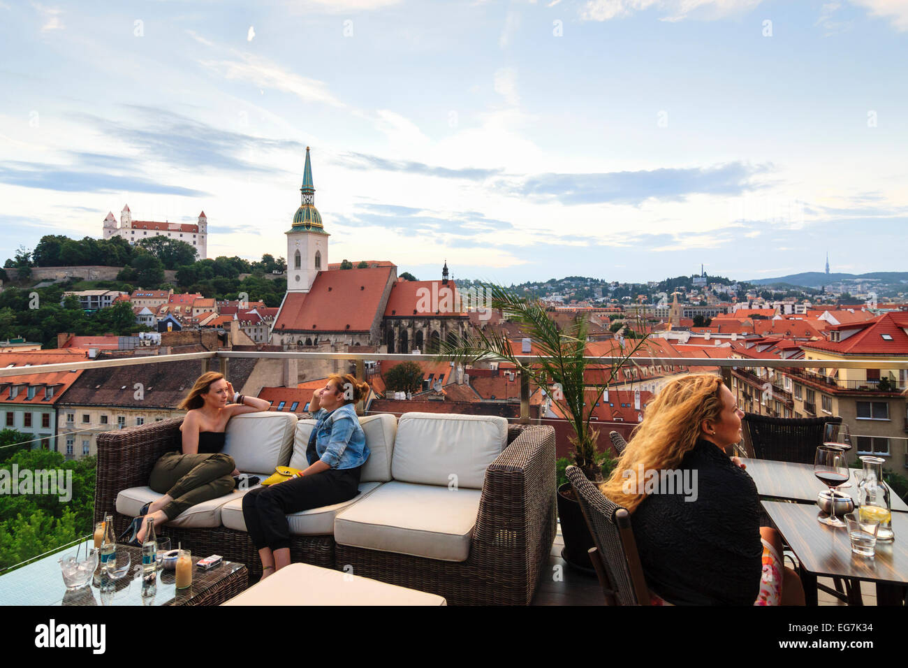 Women at panoramic Sky bar terrace overlooking old town, cathedral and castle in Bratislava, Slovakia - Stock Image