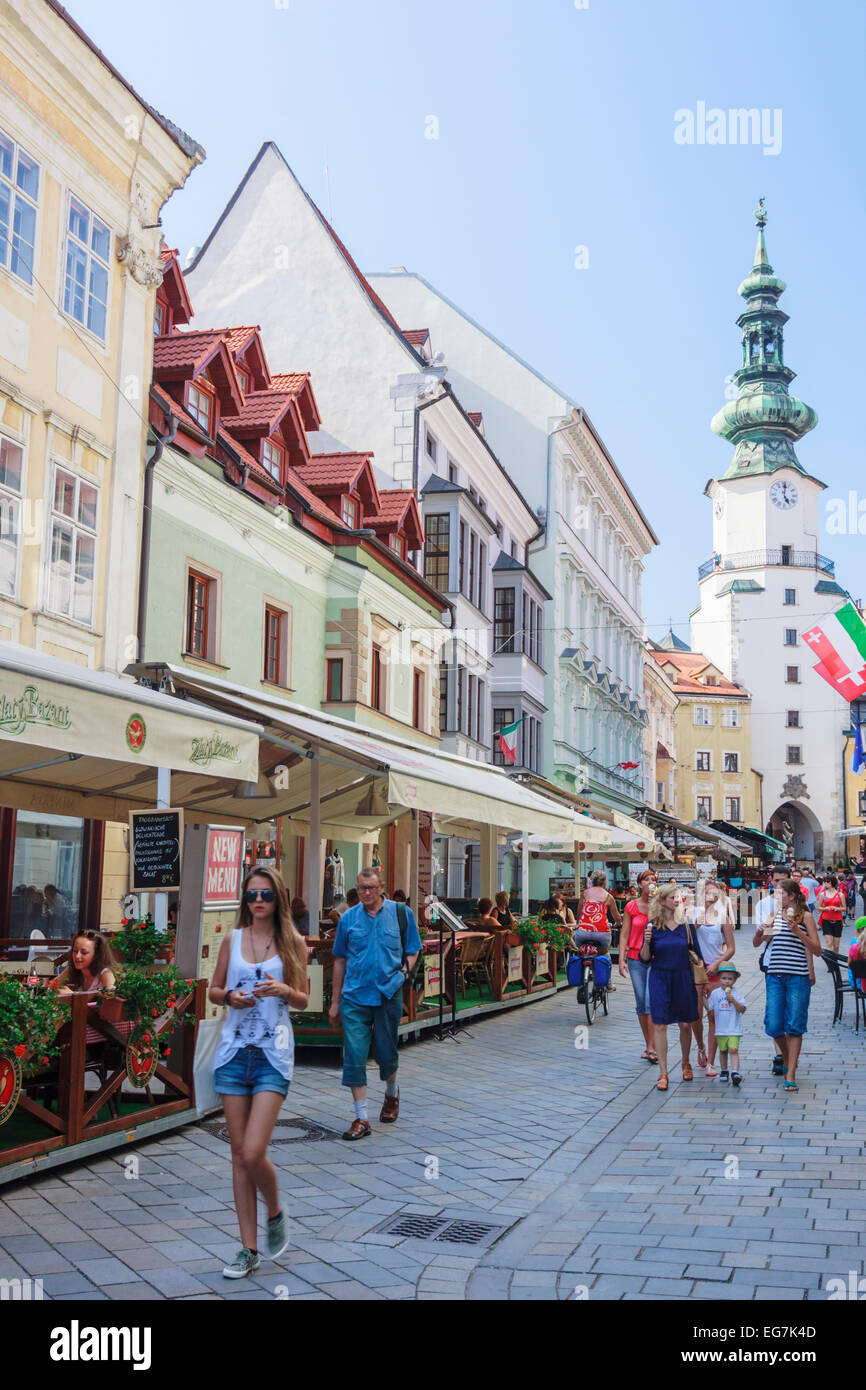 Michael's Gate and  people at Venturska Michalska the Old Town´s main street in Bratislava, Slovakia - Stock Image