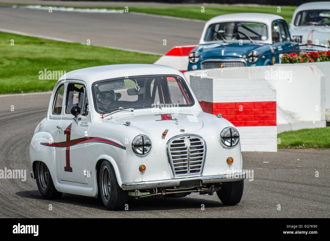 Austin A35 racing at the Goodwood Revival. Vintage motor car racing through the chicane Stock Photo