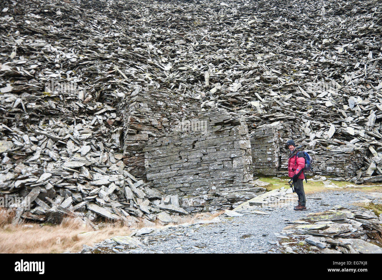 Snowdonia National Park, Gwynedd, Wales, UK. 17th February, 2015. A hiker visits the abandoned Rhosydd Slate Quarry Stock Photo