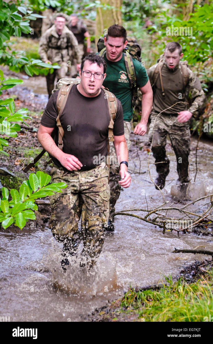 Bangor, Northern Ireland. 18th February, 2015. Soldiers run through a river during a cross-country exercise. Credit: Stock Photo