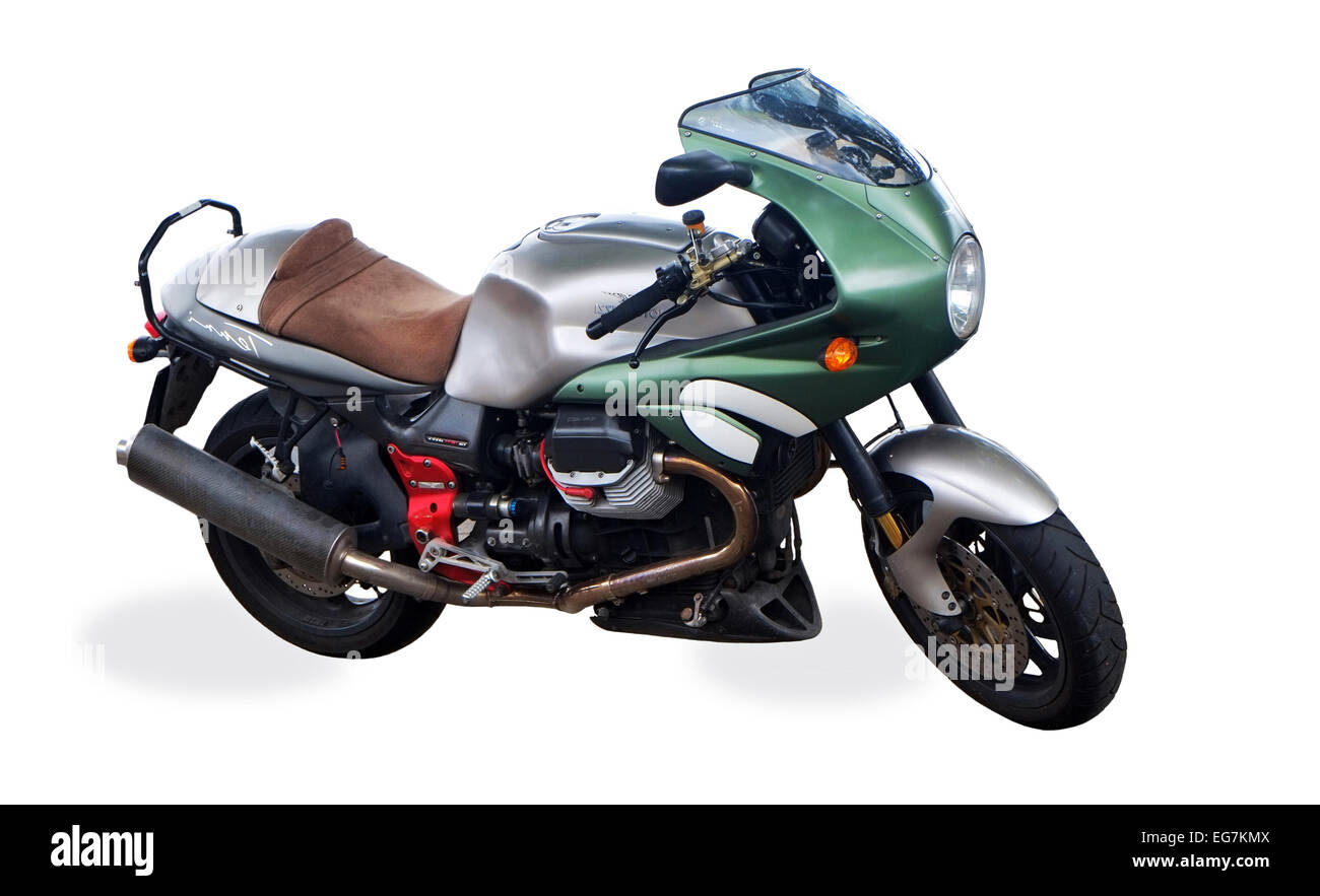 A cut-out of a powerful Moto Guzzi Cafe racer motorcycle parked on pavement in Dublin Ireland - Stock Image