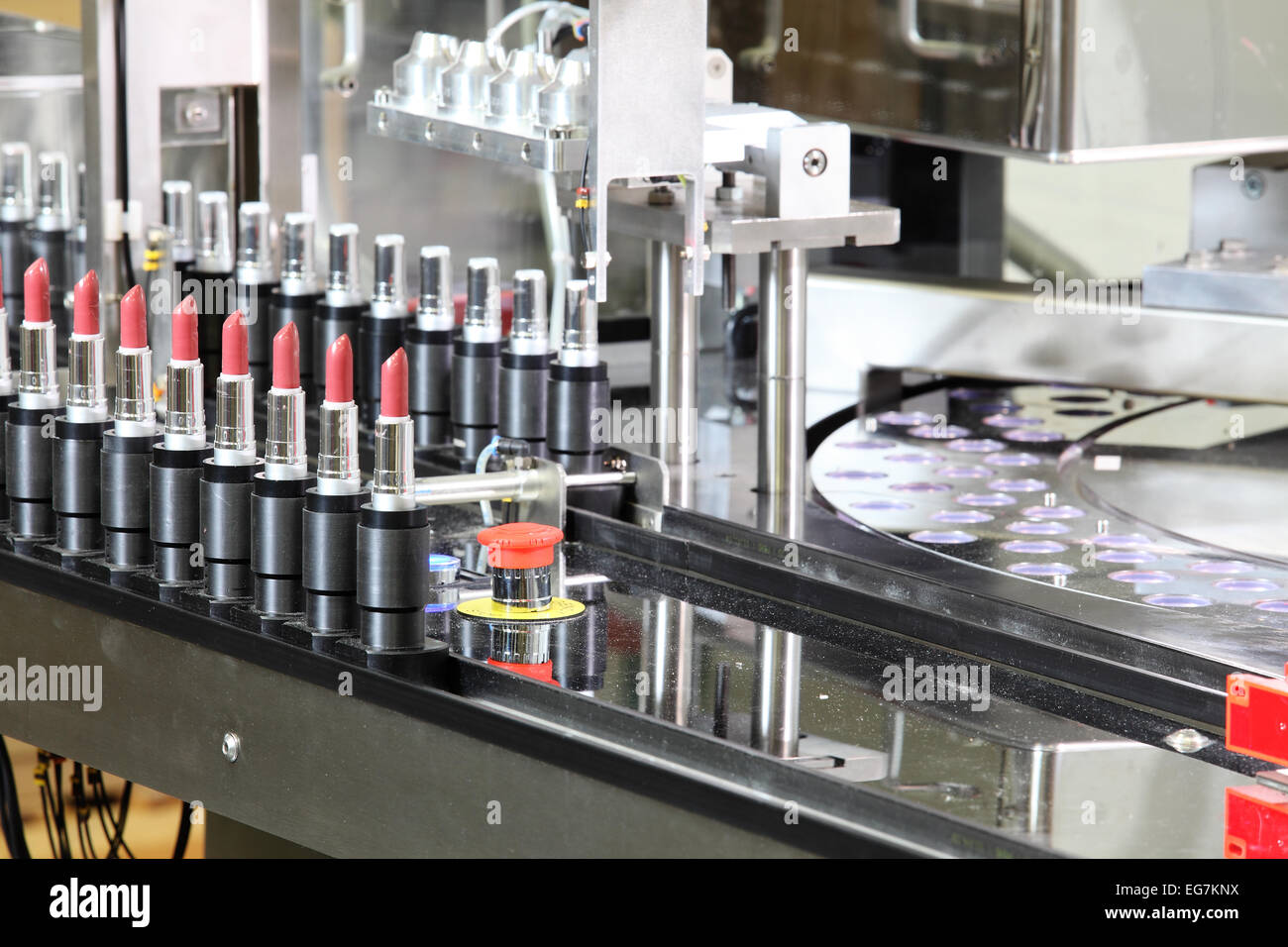A Lipstick Packaging Machine In A Cosmetics Factory Stock