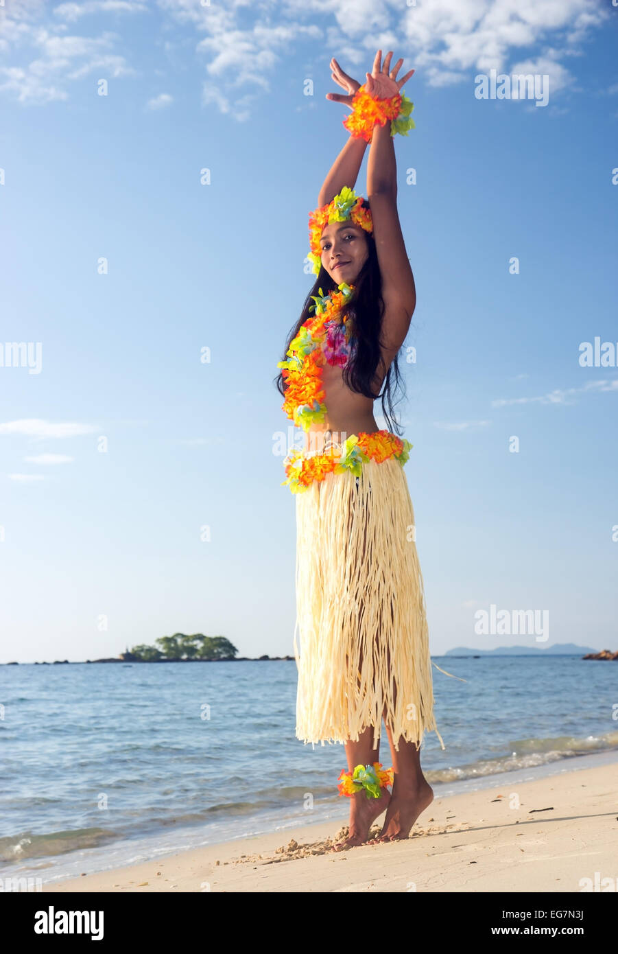 Hula Hawaii dancer dancing on the beach - Stock Image