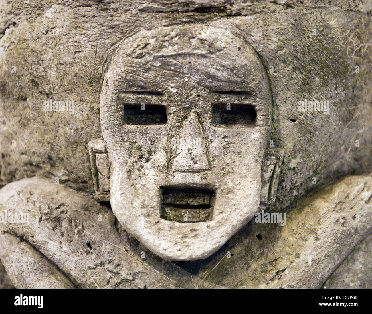 Ancient Asian stone carving of a man. - Stock Image