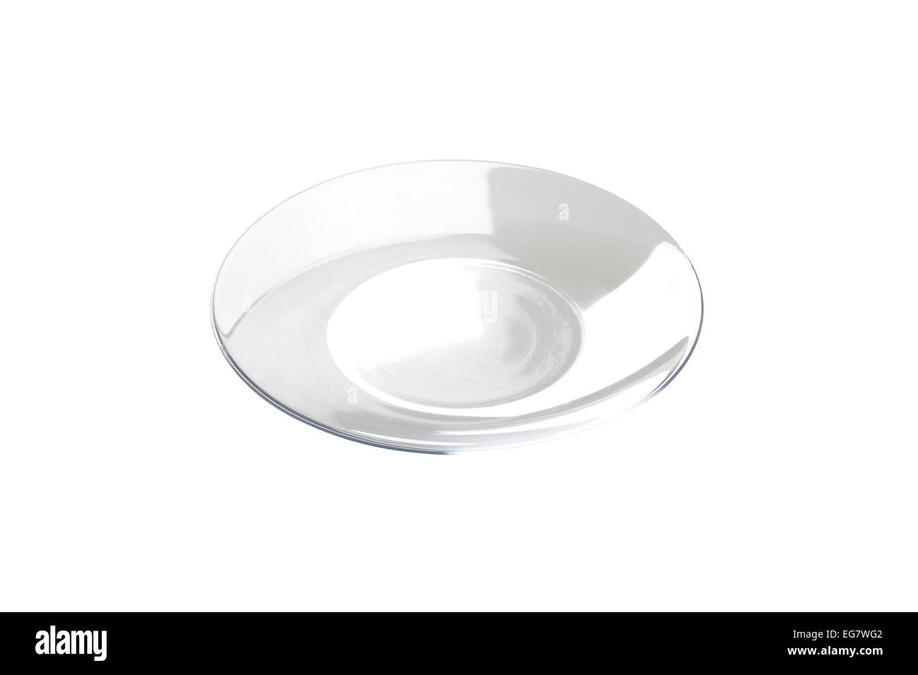 Empty transparent plate with wide rim - Stock Image