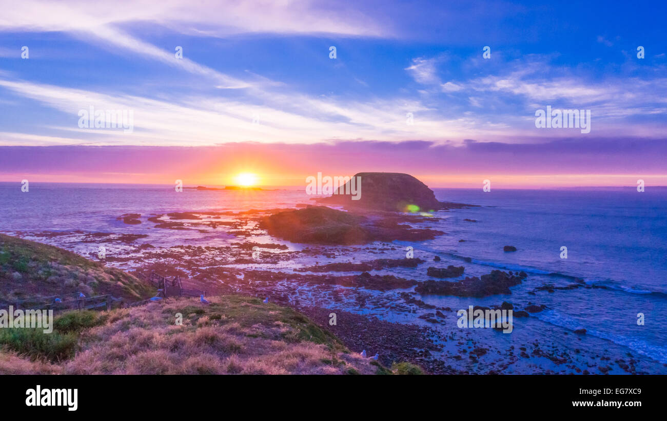 Beach landscape on sunset with cloudy sky - Stock Image