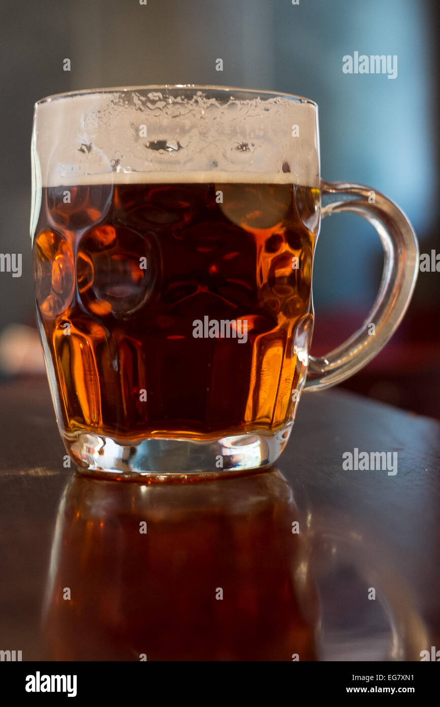 Pint of beer in a traditional dimpled glass tankard - Stock Image