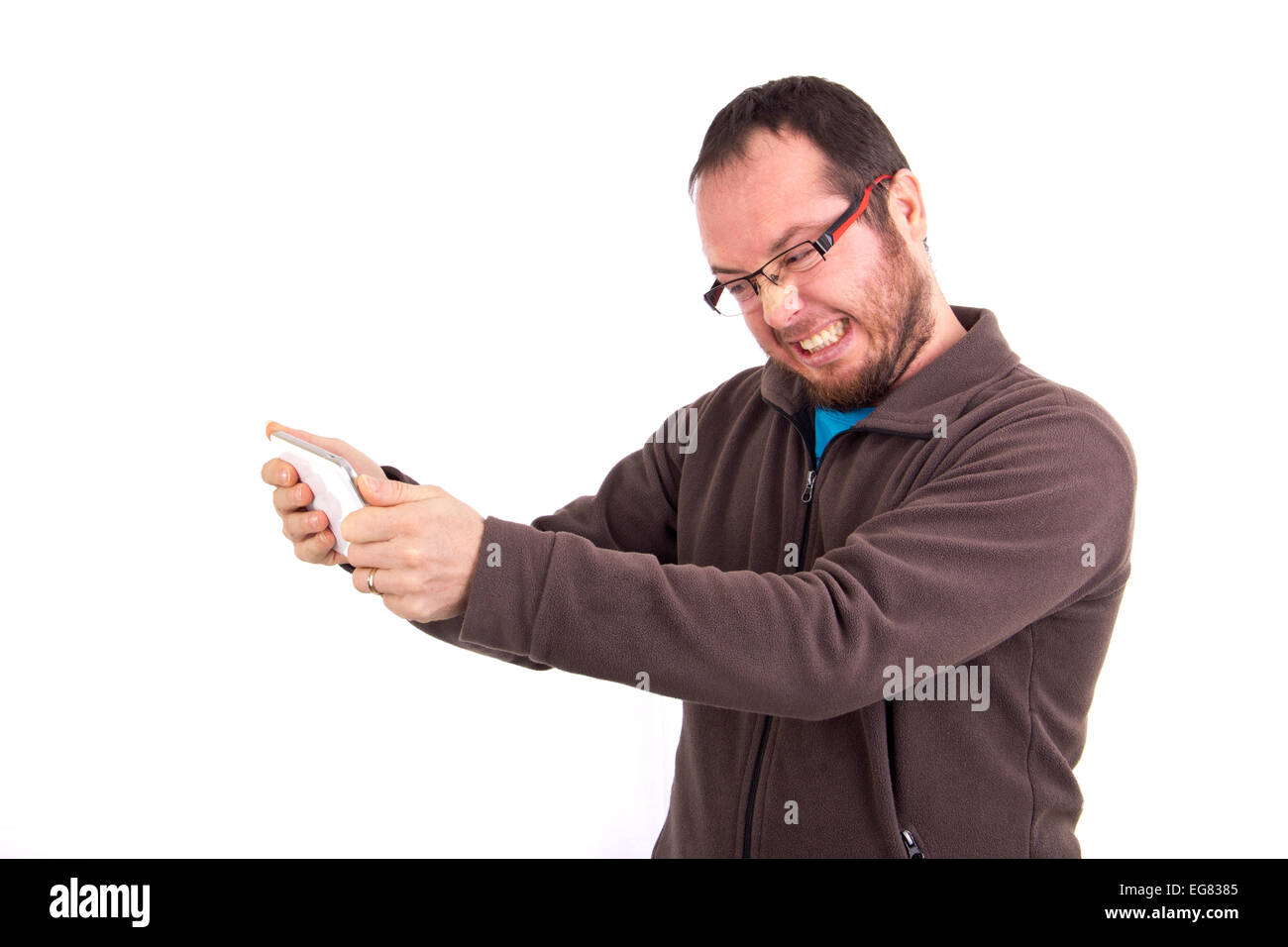 angry man sending text message on his mobile phone isolated on white background - Stock Image