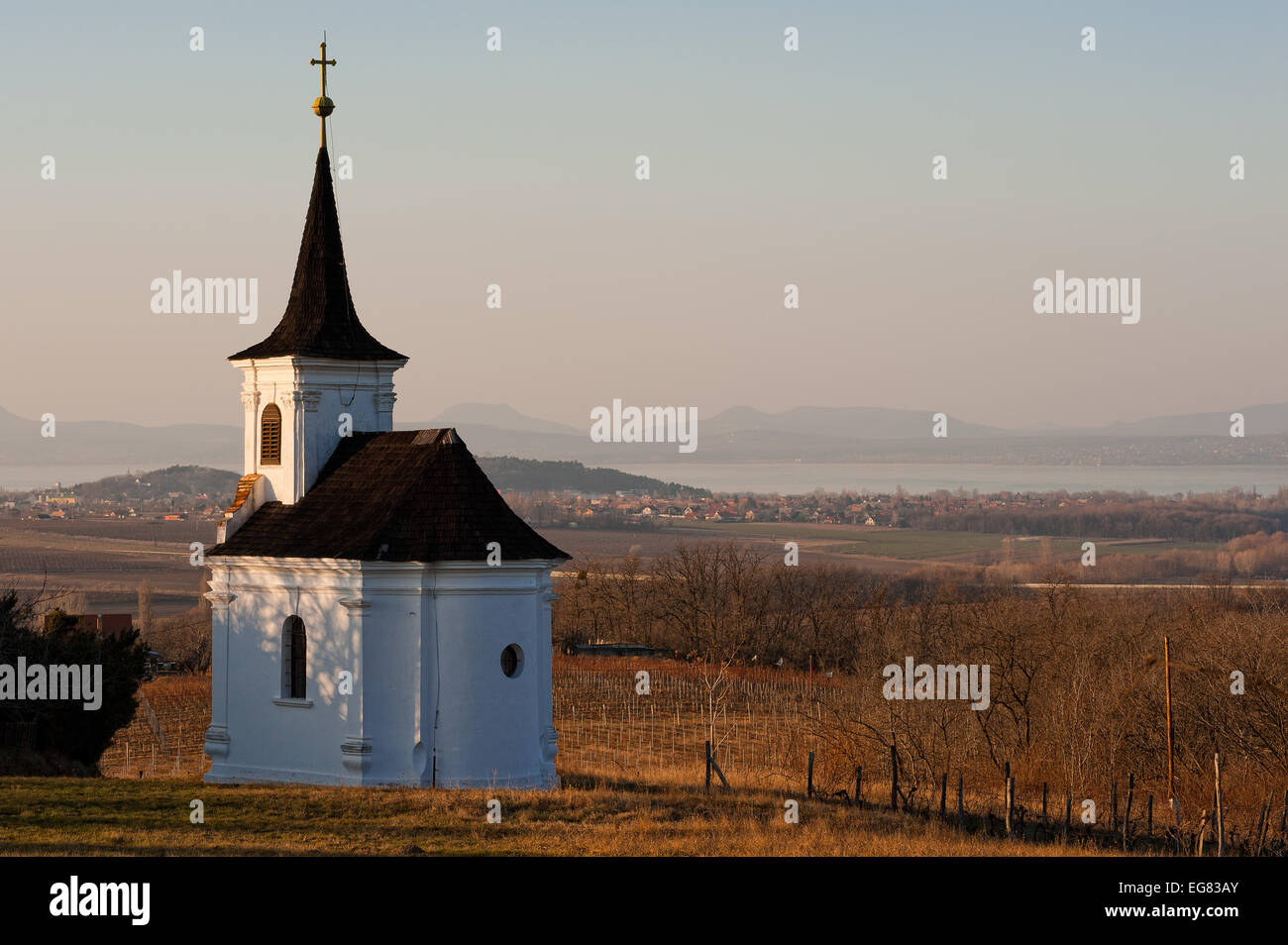 Small chapell at a wineyard with the lake of Balaton on background - Stock Image