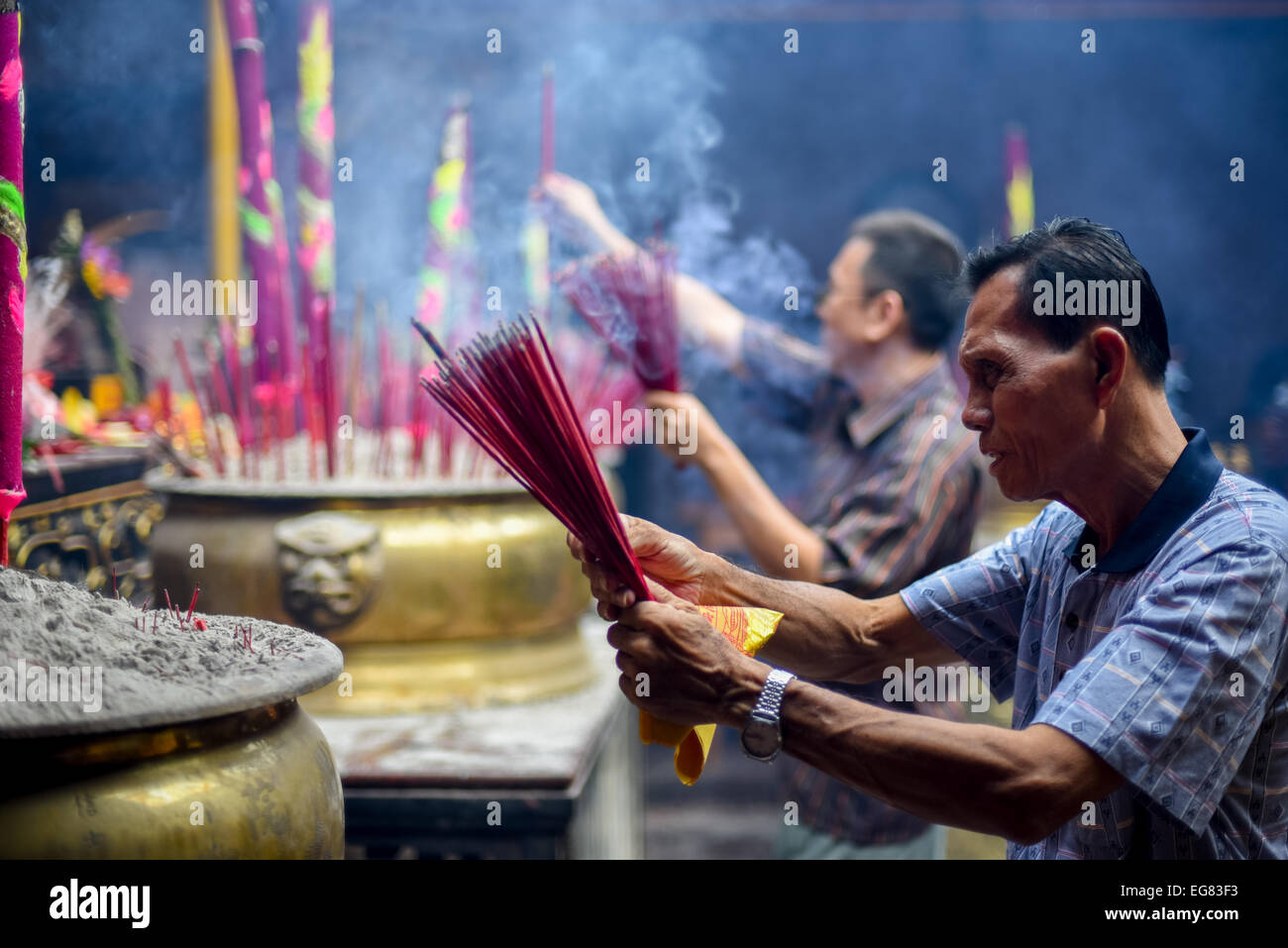 People pray with incense sticks called Hio on New Year's Eve