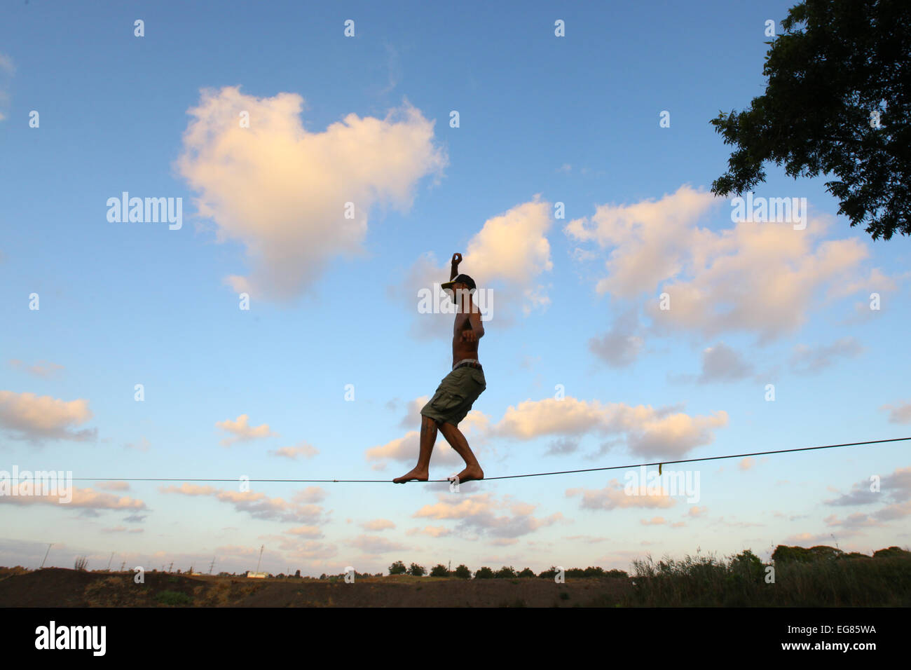 Tight rope walking as seen from below - Stock Image